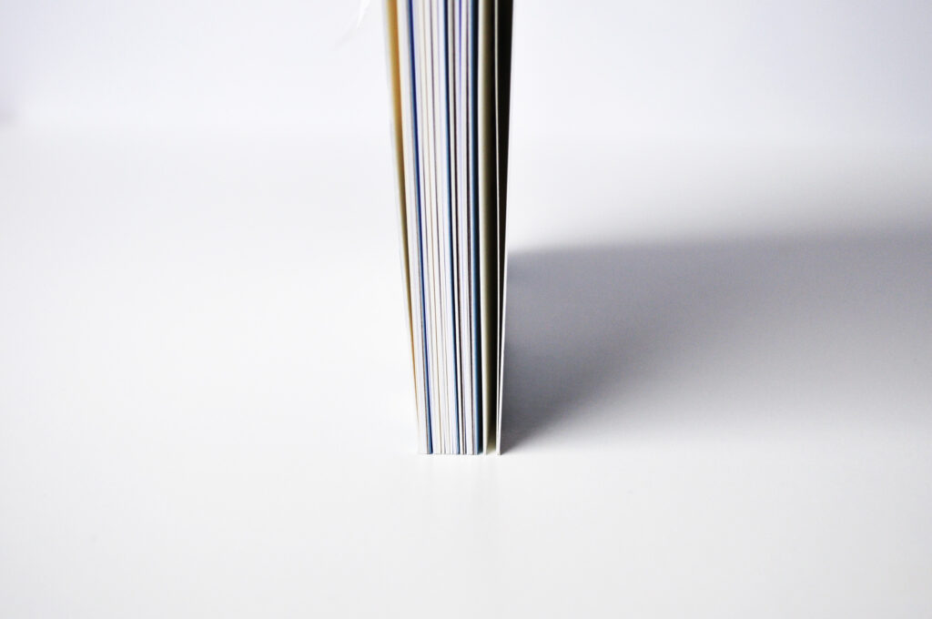 The different paper colours and types can clearly be seen from the side of the book.